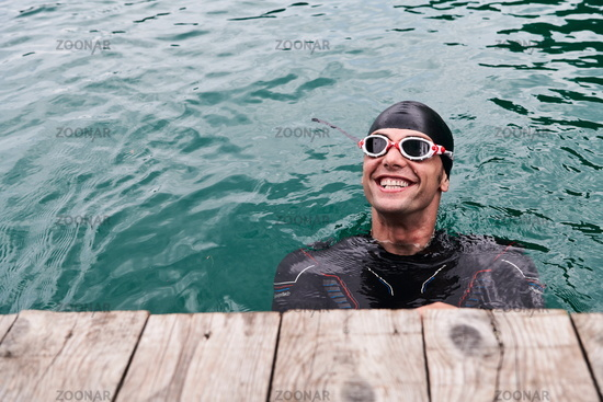 triathlete swimmer portrait wearing wetsuit on training