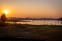 Sunset over dead trees, Nam Theun river, Thalang, Thakhek, Laos