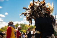 Person in festival with feathers on head