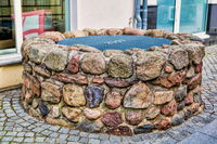 Bernau near Berlin, Germany - April 30th, 2019 - medieval fountain made of field stones