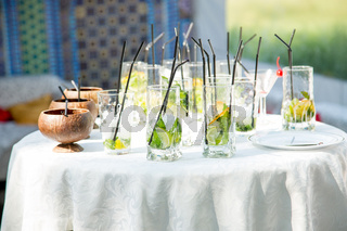 Glasses of non-alcoholic mojito on the buffet table. concept is a party. Creative subjects for design and illustrations of drinks.