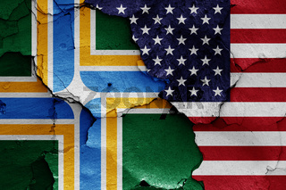 flags of Portland and USA painted on cracked wall