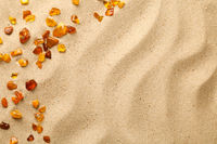 Sand Background With Scattered Ambers