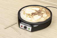 Electric pancake maker in the kitchen