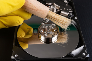 Cleaning the hard disk with a brush. Vacuuming old disk data on your computer.