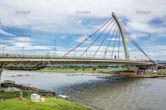 cityscape with bridge with river under sky