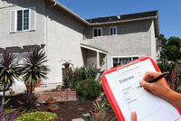 Contractor / Landscaper with clipboard writing an estimate for outdoor home improvements.