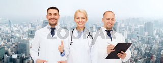 group of doctors showing thumbs up over white