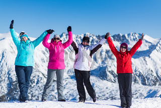 a company of women on a background of mountains in winter