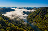 Narrow gorge of the Cheat River upstream of Coopers Rock State Park in West Virginia with fall colors