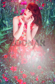 Artistic portrait of a woman amongst red poppies