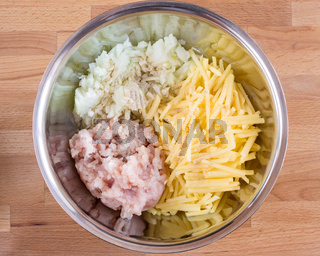 Onions, potatoes and minced meat in a bowl. Top view, ingredients for the pie