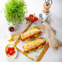 crispy baguette with bacon, tomatoes and cheese