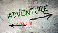 Street Sign to Adventure versus Boredom