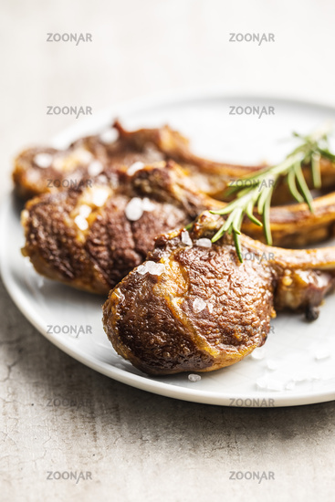 Grilled lamb chops on plate.