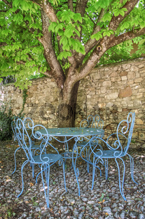 Seating group of blue chairs in the shade