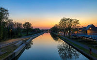 Dramatic and mesmerizing colorful sunset sky over a canal