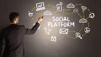 businessman drawing social media icons
