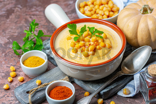 Spicy pumpkin cream soup with chickpeas.