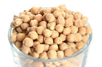 full glass of chick peas isolated on white