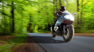 Feeling of adventure and freedom. Motorcycle tour on the country road with fresh forest air.