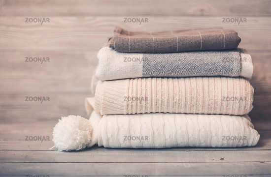 Stack of cozy knitwear in winter time