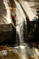 Canyoning in Tessing, Man jumping in water