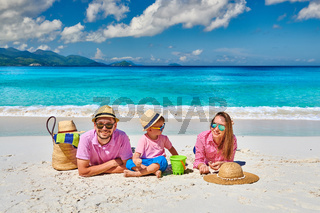 Family with three year old boy on beach. Seychelles, Mahe.