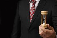 Businessman holding hourglass