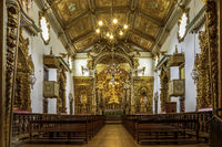 Interior of brazilian historic 18th century church in gold-plated baroque style