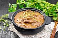 Goulash of beef in pan on dark board