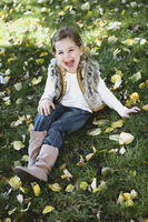 Happy little girl at autumn park