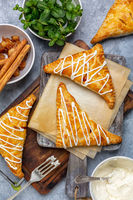 Apple turnovers with cottage cheese cream.