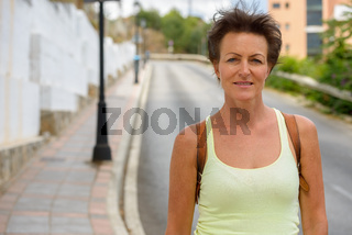 Mature beautiful tourist woman in the streets outdoors