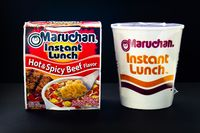 Calgary, Alberta, Canada. Oct 30, 2020. A couple of Instant Maruchan Noodle soup on a black background.