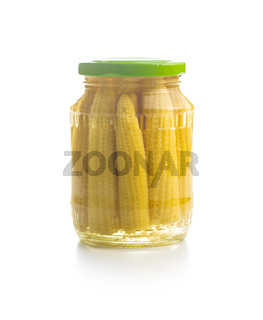 Pickled young baby corn cobs in jar