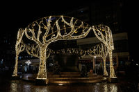Christmas decorated Teufelsbrunnen in a shopping street in Magdeburg at night