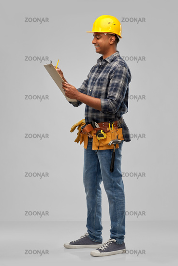 happy builder with clipboard and pencil
