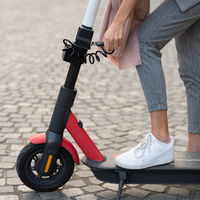 User unlocking rental electric scooter. Eco friendly green modern urban mobility concept of sharing transportation with electric scooters for rent in Ljubljana, Slovenia