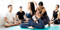 Asian Yoga coach tarining to yoga student Panorama