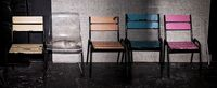Second hand chairs in front of weathered building. Job opportunity. Loft interior mock up photo.
