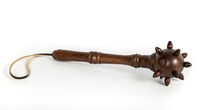 Decorative wooden mace on an isolated background.
