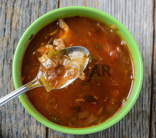 Tortilla Soup on Rustic Wood Background