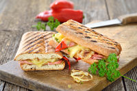 Grilled Italian sandwich with ham and vegetables