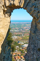 View through arch of  The Pass of the Witches in San Marino