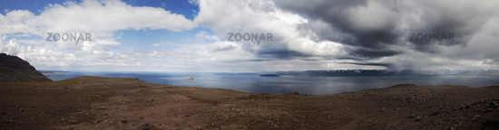 Panoramic view of Skagafjoerdur with blue sky and rain clouds, East Iceland, Iceland, Europe