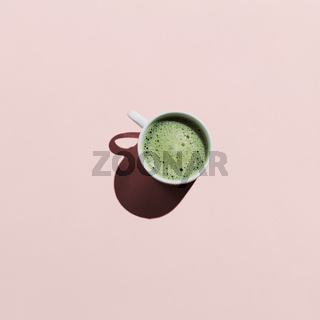 Flat lay of matcha tea on pink
