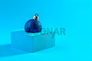 Abstract Christmas card with a shiny blue ball.