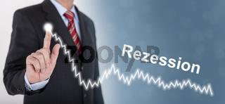 Geschäftsmann zeigt Chart mit Rezession