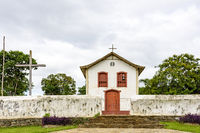 Small and old church and crucifix in colonial architecture